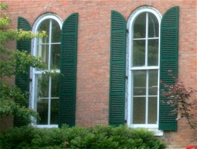 quarter-round arched exterior shutters on a Victorian Farmhouse