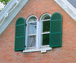 half-round arched exterior shutters on a Victorian Farmhouse