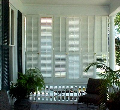 Plantation Shutters used to enclose a porch