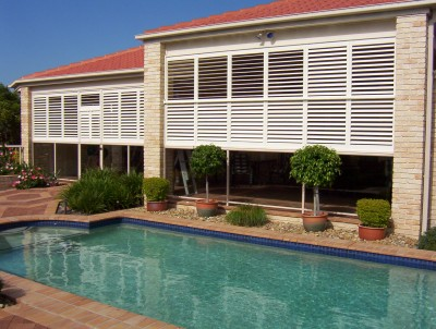 Faux Plantation Shutters Shading around a pool