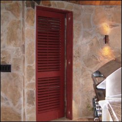 operable Louvered Doors for an outdoor bathroom