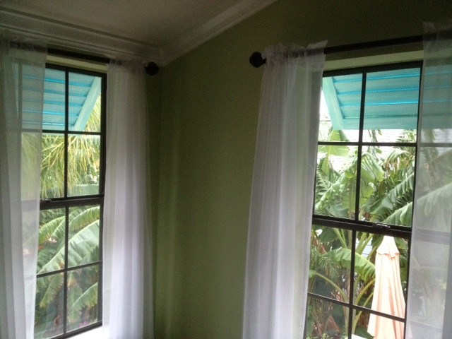 Bahama shutters as window awnings