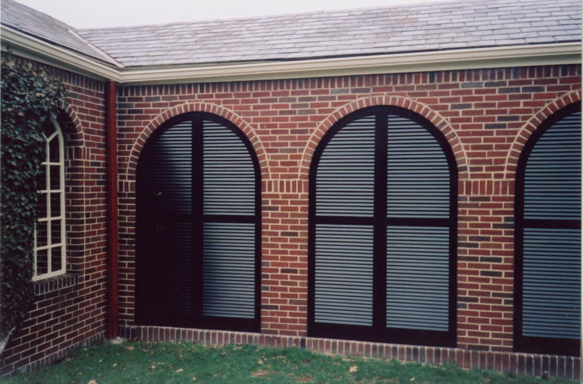 arched louvered exterior shutters