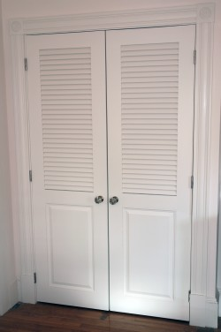 Hinged doors with wider stiles to hold knobs