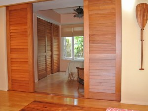 Fixed louver sliding doors made with Mahogany stave core stiles and rails