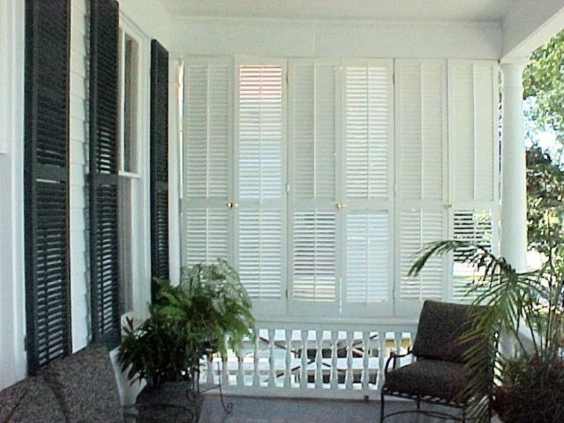 Operable louvered exterior shutters to enclose a porch for Privacy shutters for deck