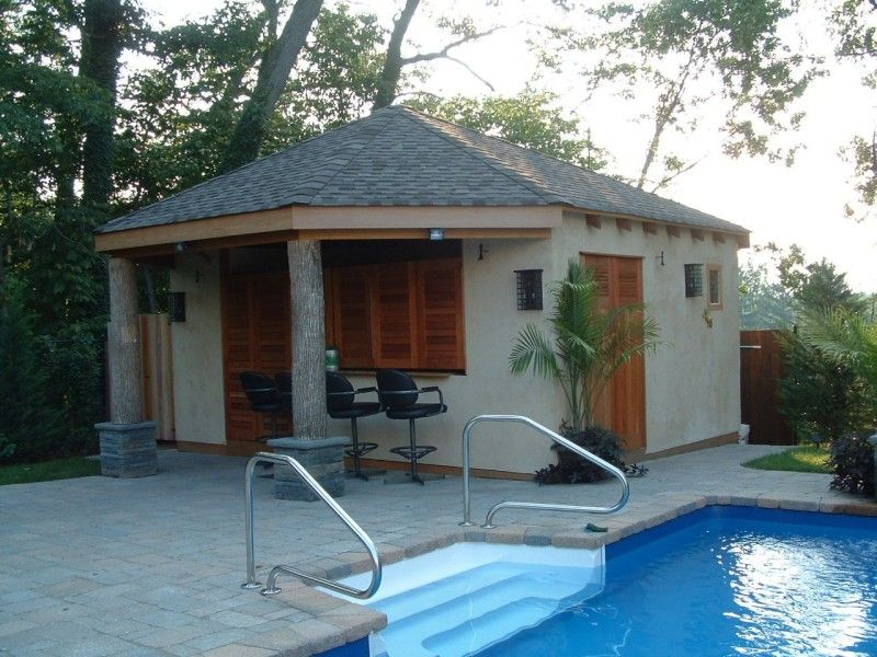 fixed louvered exterior shutters on a pool cabana
